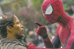 This image released by Sony Pictures shows Jamie Foxx, left, and Andrew Garfield as Spider-Man in 'The Amazing Spider-Man 2.'