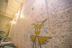 The walls of the catering room are covered with signatures of performers from over the years.