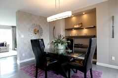 The formal dining area adds a touch of elegance.