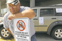 Barry Piasta, of Dog Adoption MB, has given warning signs to several local businesses.