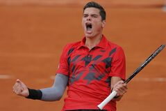 Canada's Milos Raonic celebrates winning the fourth round match of the French Open tennis tournament against Spain's Marcel Granollers at the Roland Garros stadium, in Paris, France, Sunday, June 1, 2014. Raonic won in three sets 6-3, 6-3, 6-3. (AP Photo/Michel Spingler)