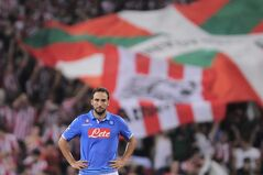 SSC Napoli's Gonzalo Higuain walks from the pitch dejected after his team lost 3-1 against Athletic Bilbao, during their Champions League playoff second leg soccer match, at San Mames stadium in Bilbao, northern Spain, Wednesday, Aug. 27, 2014.(AP Photo/Alvaro Barrientos)