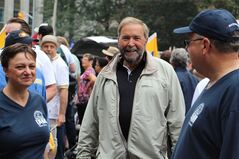 Federal NDP Leader Tom Mulcair greets participants at the annual Labour Day parade in Toronto, Monday, Sept.1, 2014. THE CANADIAN PRESS/Adam Miller
