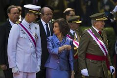 Queen Sofia, centre, talks to Crown Prince Felipe, left, as she points at King Juan Carlos, right, during a military parade on Armed Forces day, in Madrid, Spain, Sunday, June 8, 2014. King Juan Carlos plans to abdicate and pave the way for his son, Crown Prince Felipe, to become the country's next king. The 76-year-old Juan Carlos oversaw his country's transition from dictatorship to democracy but has had repeated health problems in recent years. His popularity also dipped following royal scandals, including an elephant-shooting trip he took in the middle of Spain's financial crisis that tarnished the monarch's image. The king came to power in 1975, two days after the death of longtime dictator Francisco Franco. (AP Photo/Andres Kudacki)