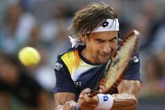 David Ferrer from Spain returns the ball during a Madrid Open tennis tournament match against Kei Nishikori from Japan in Madrid, Spain, Saturday, May 10, 2014. (AP Photo/Andres Kudacki)