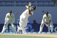 India's Ravindra Jadeja hits out to be caught by New Zealand's Ish Sodhi for 26 on the fourth day of the first cricket test at Eden Park in Auckland, New Zealand, Sunday, Feb. 9, 2014.(AP Photo/SNPA, Ross Setford) NEW ZEALAND OUT