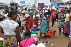 Women sell food stuff at one of the largest local markets in the city of Monrovia, Liberia, Friday, Aug. 15, 2014. The World Food Program says 1 million people in Guinea, Liberia and Sierra Leone may need food assistance in the coming months, as measures to slow Ebola's spread have caused price hikes and slowed the flow of goods to isolated areas. (AP Photo/Abbas Dulleh)