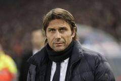 Juventus coach Antonio Conte comes onto the field ahead of an Italian Cup, round of eight, soccer match, between AS Roma and Juventus at Rome's Olympic stadium, Tuesday, Jan. 21, 2014. (AP Photo/Alessandra Tarantino)