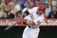 Los Angeles Angels' Josh Hamilton hits an RBI double during the first inning of a baseball game against the Chicago White Sox on Friday, June 6, 2014, in Anaheim, Calif. (AP Photo/Jae C. Hong)
