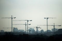 Construction cranes stand in the dust of the morning at a construction site at Leipziger Platz in Berlin, Oct. 31, 2012. THE CANADIAN PRESS/AP, Markus Schreiber