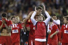 Sevilla's Reyes, center, and Daniel Carrico from Portugal celebrates on the end their Europa League semifinal second leg soccer match against Valencia at the Mestalla stadium in Valencia, Spain, Thursday, May 1, 2014. Valencia lost 2-0 in the first leg at Sevilla. The game ended 3-1 and Sevilla qualified for the final Europa League. (AP Photo/Alberto Saiz)