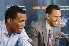 Phoenix Suns first-round draft picks Tyler Ennis, right, and T.J. Warren, speak after being introduced by the NBA basketball team, Friday, June 27, 2014, in Phoenix. (AP Photo/Matt York)