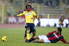 Lazio defender Luis Pedro Cavanda, left, is tackled by Bologna's Archimede Morleo, during the Serie A soccer match between Bologna and Lazio at the Renato Dall' Ara stadium in Bologna, Italy, Saturday, Jan.11, 2014. (AP Photo/Studio FN)