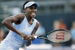 Venus Williams, of United States, rushes to return the ball during the second set of her match against Paula Kania, of Poland, in the Bank of the West Classic, Tuesday, July 29, 2014, in Stanford, Calif. (AP Photo/Beck Diefenbach)