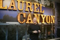 In this Friday, May 9, 2014, photo, Folk musician and photographer Henry Diltz, whose iconic photographs of Laurel Canyon are featured at the Grammy Museum show