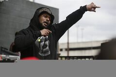 FILE - In this March 14, 2014 file photo, Schoolboy Q performs during the SXSW Music Festival in Austin, Texas. The rapper was in a vehicle that was fired on after a concert at the popular Red Rocks outdoor amphitheatre in Colorado, but he was not injured, investigators said Friday, June 20, 2014. Three other people were hurt in the shooting late Thursday in the parking lot at Red Rocks, but their injuries were not life-threatening, and one was discharged from the hospital Friday. (Photo by Jack Plunkett/Invision/AP, file)