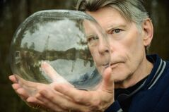 In this photo released by CBS, author and executive producer, Stephen King, poses holding a glass dome for the TV series,