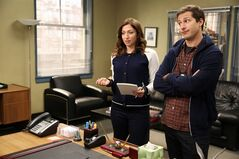 This photo released by Fox shows Andy Samberg, right, as Det. Jake Peralta, and Chelsea Peretti as Gina, in a scene from the Fox TV series,