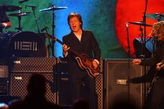 FILE - In this Jan. 27, 2014 file photo, Paul McCartney performs at The Night that Changed America: A Grammy salute to the Beatles, in Los Angeles. The pop legend is set to return to Candlestick Park to offer a swan song to the San Francisco 49ers' former stadium. McCartney's website posted a statement Thursday, April 24, 2014, confirming that the former Beatle will perform on Aug. 14, 2014, at what is being billed as the last concert at Candlestick. (Photo by Zach Cordner/Invision/AP, file)