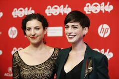 FILE - In this Mon., Jan. 20, 2014 file photo, writer and director Kate Barker-Froyland, left, and cast member Anne Hathaway, pose together at the premiere of the film