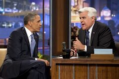 FILE - In this Aug. 6, 2013 file photo, President Barack Obama, left, talks with Jay Leno during a commercial break during the taping of his appearance on