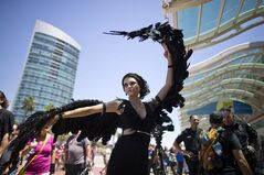 A woman dressed as the character Katniss Everdeen from the movie,