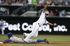 San Diego Padres second baseman Chris Nelson, right, comes off the base as New York Mets' Curtis Granderson steals second during the third inning of a baseball game Friday, July 18, 2014, in San Diego. (AP Photo/Gregory Bull)