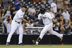 San Diego Padres' Rene Rivera is greeted by third base coach Glenn Hoffman after hitting a home run to tie the baseball game in the bottom of the ninth inning against the Milwaukee Brewers on Wednesday, Aug. 27, 2014, in San Diego. (AP Photo/Gregory Bull)