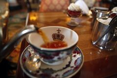 A cup of tea is poured at the Fairmont Empress Tea Room in Victoria on Wednesday, May 7, 2014. THE CANADIAN PRESS/Chad Hipolito