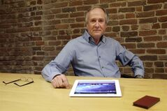 In this Friday, Feb. 21, 2014, photo, Mike Ramsay, CEO of Qplay, poses for photographs after giving a demonstration of Qplay on a tablet device in San Francisco. (AP Photo/Jeff Chiu)