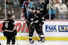 Anaheim Ducks' Nick Bonino(13) celebrates his goal with Corey Perry(10) during the second period of an NHL hockey game against the Vancouver Canucks on Wednesday, Jan. 15, 2014, in Anaheim, Calif. (AP Photo/Jae C. Hong)