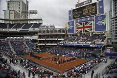 Players line the court during the pening ceremony for a Davis Cup tennis match between the United States and Great Britain, that takes place in the left field corner at Petco Park, home fo the San Diego Padres baseball team, Friday, Jan. 31, 2014, in San Diego. (AP Photo/Lenny Ignelzi)