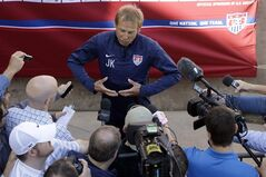 U.S. men's soccer coach Jurgen Klinsmann answers questions during training camp in preparation for the World Cup, Wednesday, May 21, 2014, in Stanford, Calif. (AP Photo/Marcio Jose Sanchez)