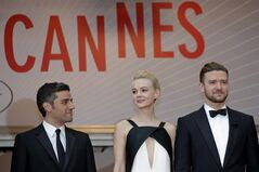 From left, actors Oscar Isaac, Carey Mulligan and Justin Timberlake arrive for the screening of the film Inside Llewyn Davis at the 66th international film festival, in Cannes, southern France, Sunday, May 19, 2013. (AP Photo/Lionel Cironneau)