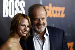 FILE - In this Oct. 6, 2011 file photo, cast member, Kelsey Grammer, right, and wife, Kayte Grammer, arrive at the premiere for the television series
