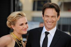 Anna Paquin, left, and Stephen Moyer arrive at the Los Angeles premiere of the 7th and final season of