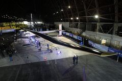 The Solar Impulse solar-powered plane is displayed during a new conference at Moffett Airfield, NASA Ames Research Center in Mountain View, Calif., on Thursday, March 28, 2013. A solar-powered plane that has wowed aviation fans in Europe is set to travel across the United States with stops in Phoenix, Dallas, Washington, D.C., and New York, organizers of the trip announced Thursday. The Solar Impulse is powered by about 12,000 photovoltaic cells that allow it to fly without jet fuel. It has the wing span of a commercial airplane but the weight of the average family car. (AP Photo/Tony Avelar)