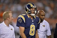St. Louis Rams quarterback Sam Bradford (8) leaves the field after getting hit by Cleveland Browns defensive end Armonty Bryant in the first quarter of a preseason NFL football game Saturday, Aug. 23, 2014, in Cleveland. (AP Photo/David Richard)
