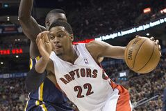 Toronto Raptors' Rudy Gay (22) drives pass Indiana Pacers' Lance Stephenson during first half an NBA basketball game in Toronto, Friday, March 1, 2013. (AP Photo/The Canadian Press, Chris Young)
