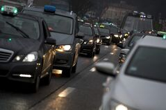 Taxi drivers slow the traffic during a protest in Lyon, central France, Thursday, Jan. 10, 2012. Taxi drivers across France were putting on the brakes to clog traffic, slow access to airports and force would-be passengers to find alternate transport in a strike over government efforts to deregulate the transportation industry. (AP Photo/Laurent Cipriani)