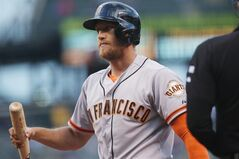 San Francisco Giants' Hunter Pence reacts after being called out on strikes against the Colorado Rockies in the first inning of a baseball game in Denver on Wednesday, May 21, 2014. (AP Photo/David Zalubowski)