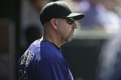 Colorado Rockies manager Walt Weiss looks on against the San Francisco Giants in the seventh inning of the Giants' 4-2 victory in a baseball game in Denver on Monday, Sept. 1, 2014. The game was resumed in the bottom of the sixth inning of play when it was suspended because of rain on May 22. (AP Photo/David Zalubowski)