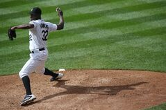 Colorado Rockies relief pitcher LaTroy Hawkins works against the Washington Nationals in the ninth inning of the Rockies' 6-4 victory in a baseball game in Denver on Wednesday, July 23, 2014. (AP Photo)