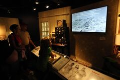 In this Monday June 16, 2014 photo, a display of the days leading up to and the day three men recorded the highest land wind speed is seen at the Extreme Museum on the top of Mount Washington. The new Extreme Mount Washington museum recently underwent a $1 million transformation from a modest collection of artifacts behind glass to a modern facility packed with hands-on exhibits. (AP Photo/Jim Cole)