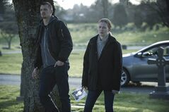Joel Kinnaman (left) and Mireille Enos (right) are pictured in a scene from Netflix's