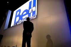 BCE CEO George Cope watches a presentation at the company's AGM in Toronto on May 9, 2013. BCE Inc. says it will privatize regional telecom affiliate Bell Aliant, acquiring the interest of public minority shareholders for roughly $3.95 billion. THE CANADIAN PRESS/Chris Young