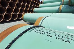 some of about 500 miles worth of coated steel pipe manufactured by Welspun Pipes, Inc., originally for the Keystone oil pipeline, is stored in Little Rock, Ark., in this May 24, 2012 file photo. TransCanada says it's pleased with the U.S. State Department's latest report into its controversial Keystone XL oil pipeline proposal, but acknowledges there's some ways to go before it can start construction. THE CANADIAN PRESS/AP-Danny Johnston