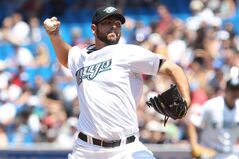 Toronto Blue Jays pitcher Carlos Villanueva works against the New York Yankees during first inning MLB action in Toronto Sunday July 17, 2011. The Blue Jays signed right-hander Villanueva to a one-year contract worth US$2,277,500 million Tuesday, thus avoiding arbitration. THE CANADIAN PRESS/Darren Calabrese