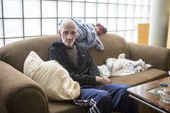 Dan Thibideau sits in his room at Toronto's Fred Victor transitional housing centre on Wednesday, July 30 , 2014. Thibideau, who has cancer, is the first patient of the PEACH (Palliative Education and Care for the Homeless) program. THE CANADIAN PRESS/Chris Young