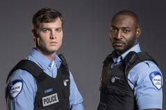 Actors Jared Keeso and Adrian Holmes are shown in a promotional photo for the TV series